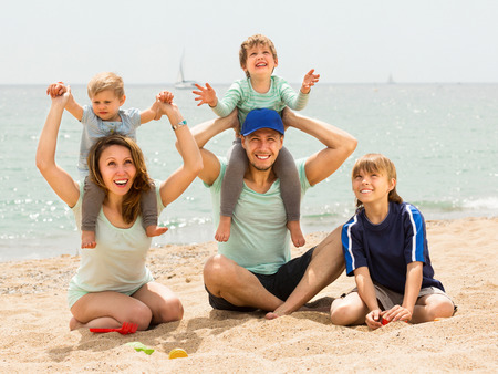 Happy family of five  in vacation at seaside photo