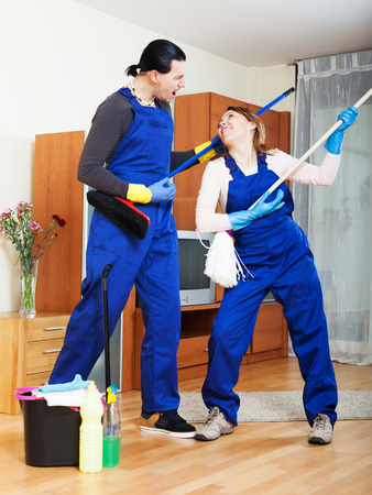 houseman: Playful cleaning premises team in uniform is ready to work Stock Photo