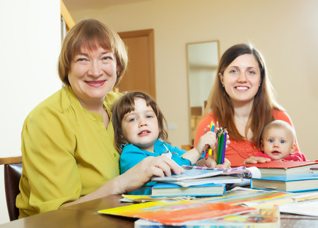 Happy elderly woman  with daughter and grandchildren at home photo