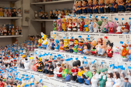 defecation: BARCELONA, SPAIN - DECEMBER 12: Modern caricature  caganers on counter of Christmas market on December 12, 2013 in Barcelona, Spain. Caganer is figurine depicted in the act of defecation Editorial