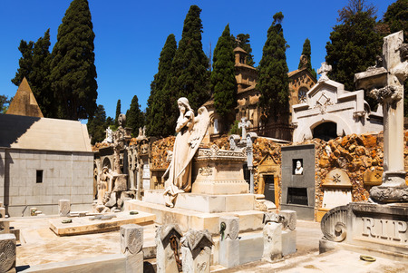 montjuic: BARCELONA, SPAIN - JULY 20, 2014: Montjuic Cemetery is located on one of  rocky slopes of Montjuic hill