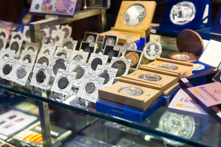 numismatics: BARCELONA, SPAIN - OCTOBER 28, 2014: Gold and silver coins on counter at numismatics store