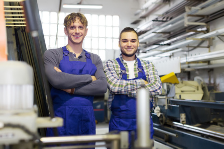 toolroom: Happy professional workers in uniform at modern plant