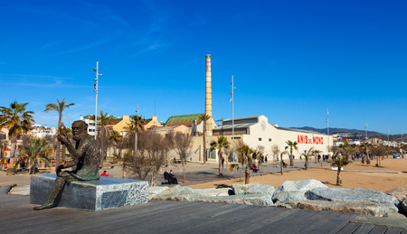 fabrica: BADALONA, SPAIN - MARCH 2, 2014: Fabrica and statue of symbol of Anis del Mono - registered trademark of anise popular Spanish origin (Badalona) brand