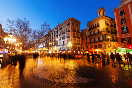 BARCELONA, SPAIN - MARCH 13, 2014: Pavement mosaic by Joan Miro on la Rambla in evening. Barcelona