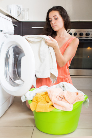unsatisfactory: Unhappy  woman using washing machine at home