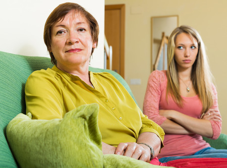 fracas: adult daughter and mother having quarrel at home Stock Photo