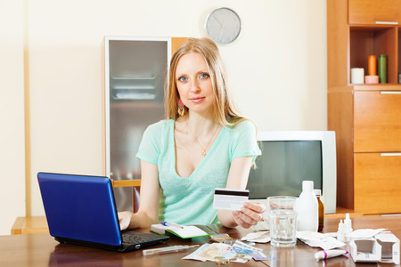 Blonde long-haired girl buying medication in online pharmacy at home