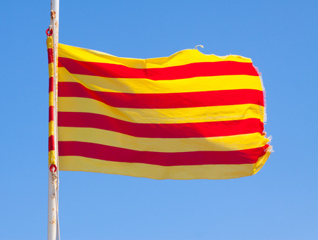 independency: Catalan flag  in flight against blue sky Stock Photo