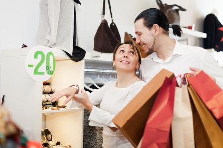 smiling couple  choosing  bracelet at  shop photo