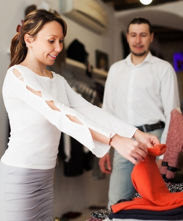 Family choosing clothes at fashion store together photo