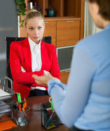 conversation: Female having difficult conversation with employee