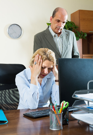 careless: Office scene with angry chief and careless elderly female secretary