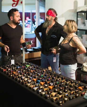 17th: BARCELONA, SPAIN - OCTOBER 3, 2014: Salon with different professional tattoo machines for sale at shopcase. The 17th edition of The Barcelona Tattoo Expo in Fira de Barcelona. Editorial