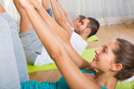 Group having fitness class in sport club and smiling. Focus on girl