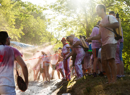 vino: HARO, SPAIN - JUNE 29, 2014: Begining of Haro Wine Festival festival.  People pour wine at each other from buckets during festival Batalia de Vino Editorial