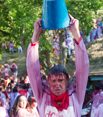 vino: HARO, SPAIN - JUNE 29, 2014: Man at Haro Wine Festival festival. People pour wine at each other from Botas and buckets during festival Batalia de Vino