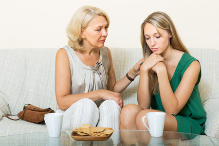 scandal: Mature mother tries reconcile with adult daughter after quarrel Stock Photo
