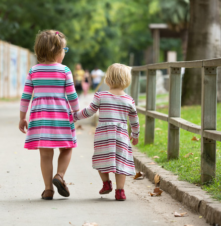 3 4 length: Rear view of two little girls   in summer Stock Photo