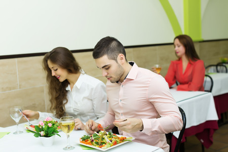 people having a dinner at the restaurant. Focus on  man photo