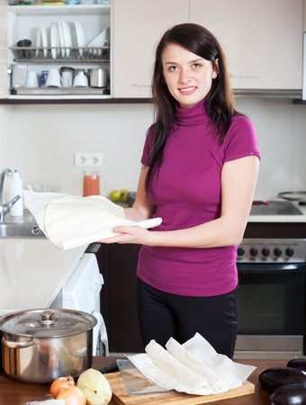 prepack: Smiling girl cooking with store-bought dough at home