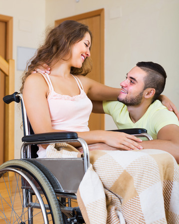 the spouse: Portrait of smiling couple with disabled spouse in love