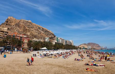 sandbank: ALICANTE, SPAIN - APRIL 14, 2014: People at Mediterranean beach in Alicante, Spain