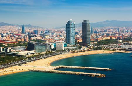 sandbank: aerial view of Barcelona from Mediterranean sea. Barceloneta beach and Port Olimpic