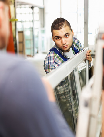 glasswear: Two  careful men checking windows at factory Stock Photo