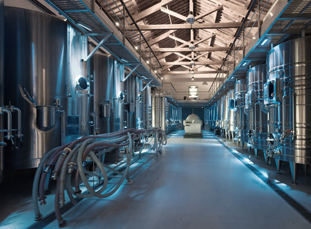 stell: Interior  of contemporary winery with  stell barrels