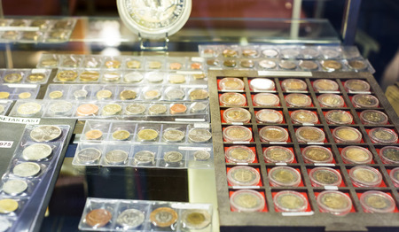numismatics: BARCELONA, SPAIN - OCTOBER 28, 2014: Collection of gold and silver coins at numismatics store Editorial