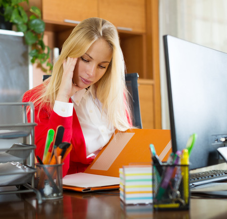 flue: Young blonde girl with flue working at office