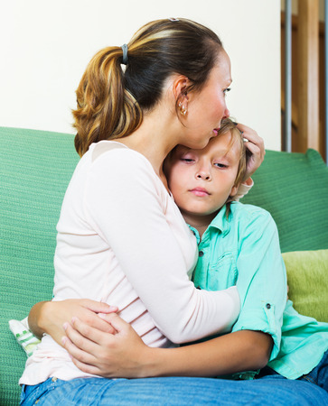 fracas: middle-aged woman comforting crying teenager
