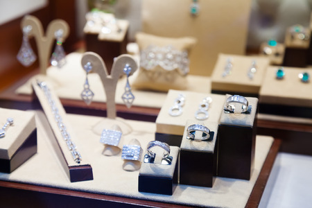 retail chain: silver jewelry at showcase of store Editorial