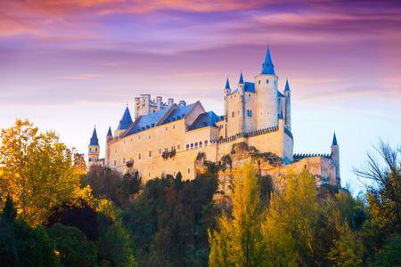 castile: Autumn dusk view of Castle of Segovia. Castile and Leon, Spain