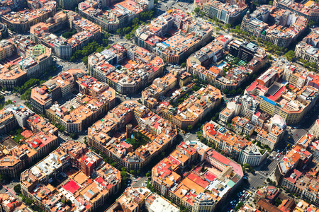 Aerial view of  typical buildings of Barcelona cityscape from helicopter. Catalonia, Spain