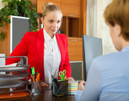 Woman having difficult conversation with employee