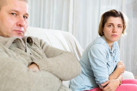 ordinary woman: Couple quarrel.Sad ordinary woman against depression man at home