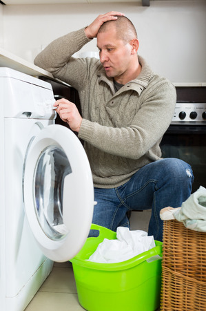 figure out: Mature man cant figure out how to use washing machine