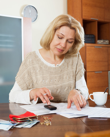 speculate: Wistful  woman thinking about the financial issue at  home Stock Photo