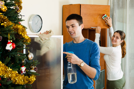 doing chores: Smiling couple together doing chores at home interior  in winter Stock Photo