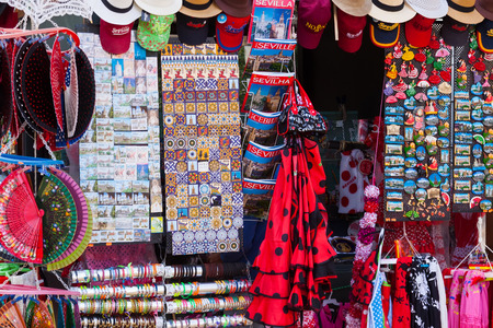SEVILLE, SPAIN - NOVEMBER 19, 2014:  Sale of Seville tourist gifts near  Plaza de Espana. Seville