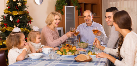 holiday gathering: Christmas celebration in the bosom of family at the table at home
