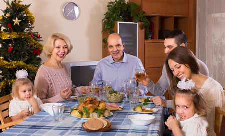 bosom: Celebration of christmas in the bosom of family at the table at home