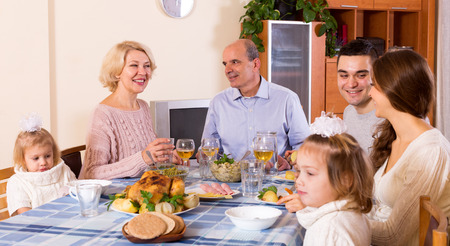 bosom: Cheerful dinner in the bosom of happy family indoor