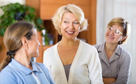 smiling mature women posing at home interior photo