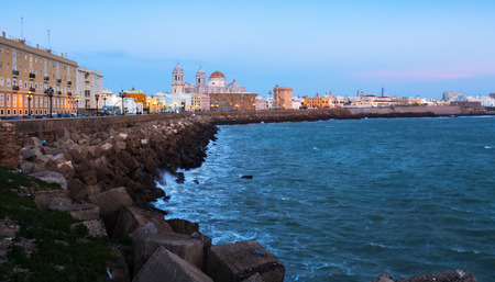 Ocean   embankment and Cathedral in twilight time. Cadiz, Spain Stock Photo