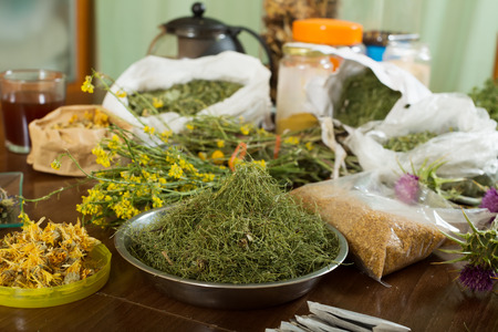 concoct: herbs at table in home  for brews Stock Photo