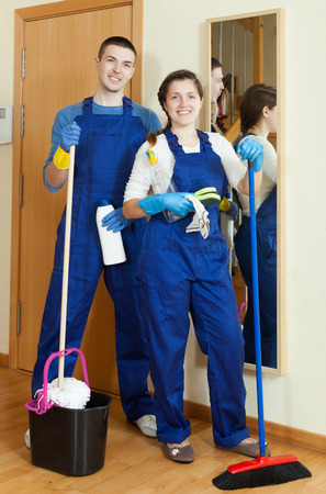 doing chores: Team of professional cleaners doing chores in your company