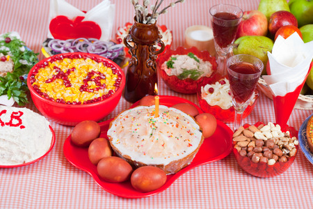 paskha: Easter cake and other meal on festive table Stock Photo